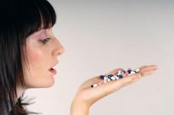 Прием обезболивающих таблеток при головной боли во время климакса